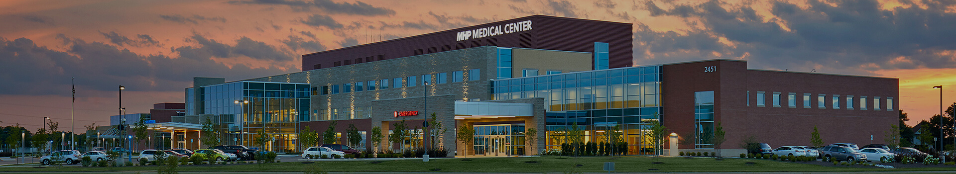 Major Health Partners Medical Center facility with a sunset background