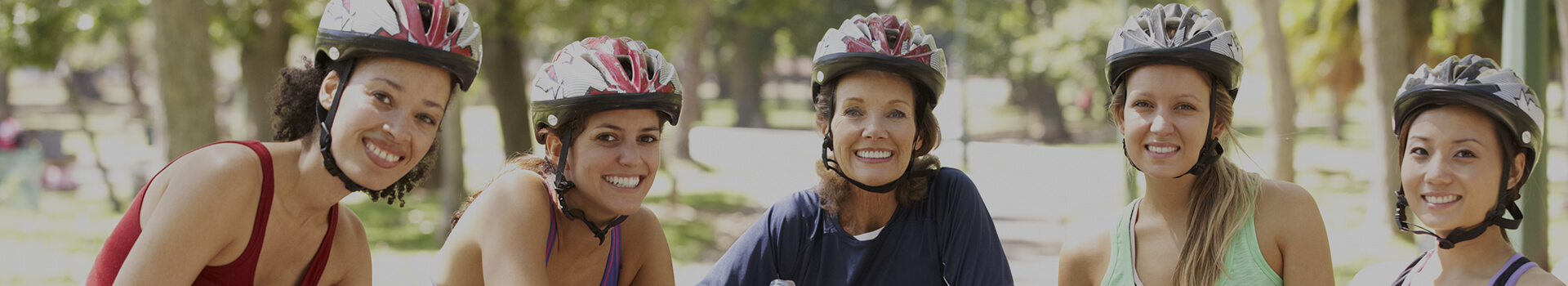 group of women with bicycle helmets on